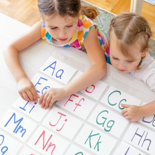Children at the Table Learning The Alphabet