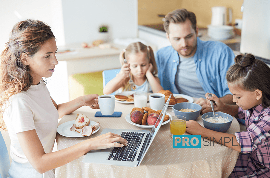 Busy Mom with Family at Breakfast Table