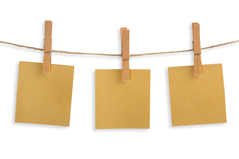 Clothes line string and clothespins holding index cards